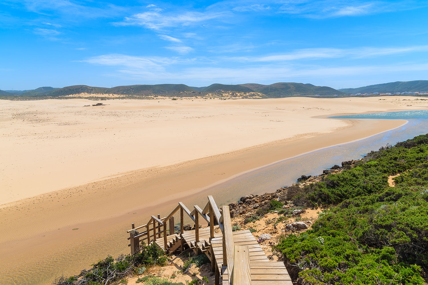 Wooden walkway to sandy Praia do Bordeira, Algarve, Portugal
