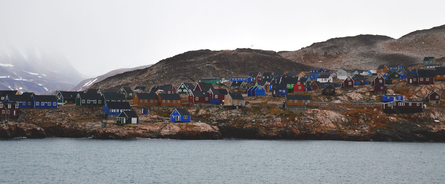 Village on shores of Greenland, kayaking