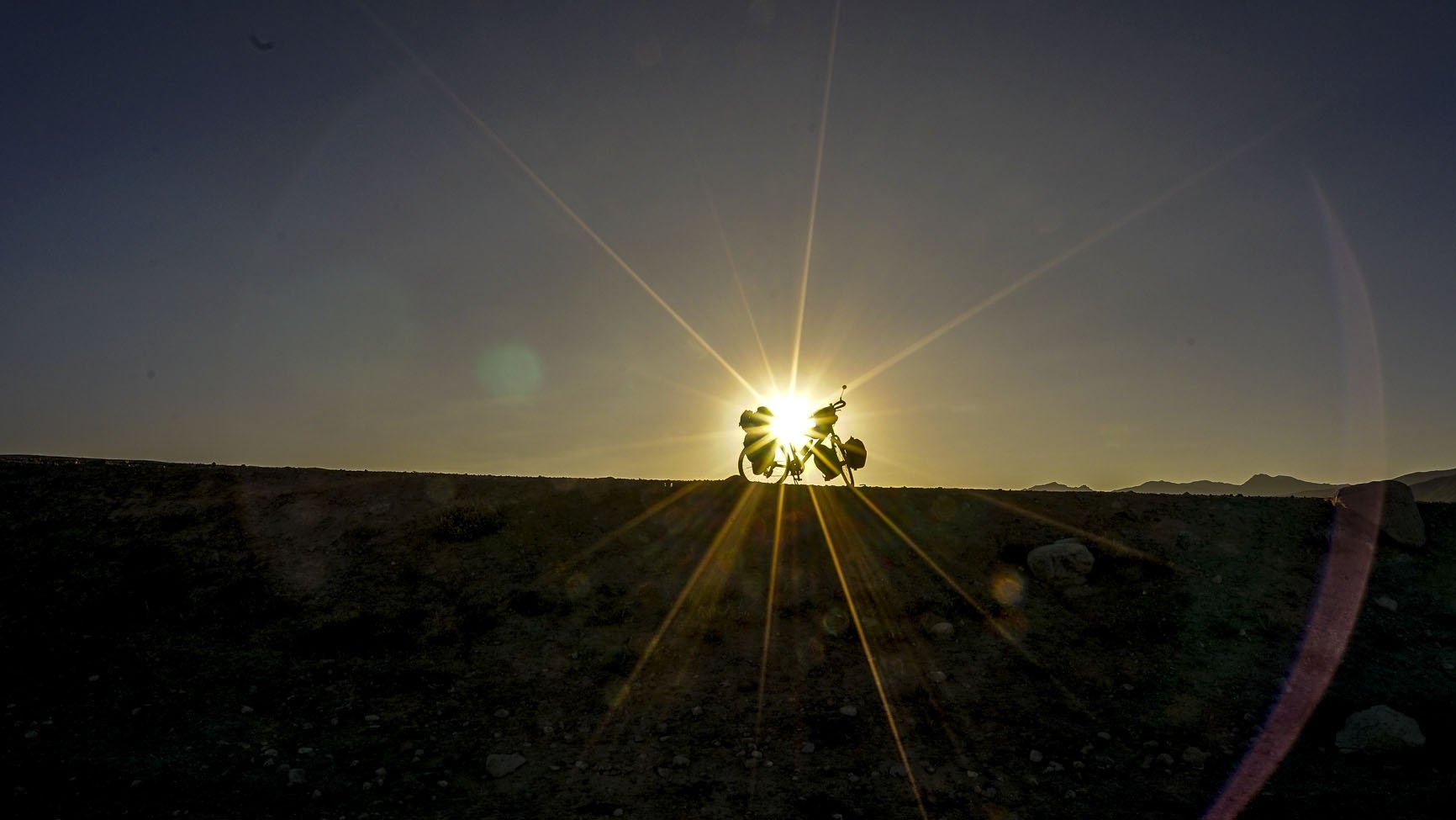 Bike silhouetted against the sunrise